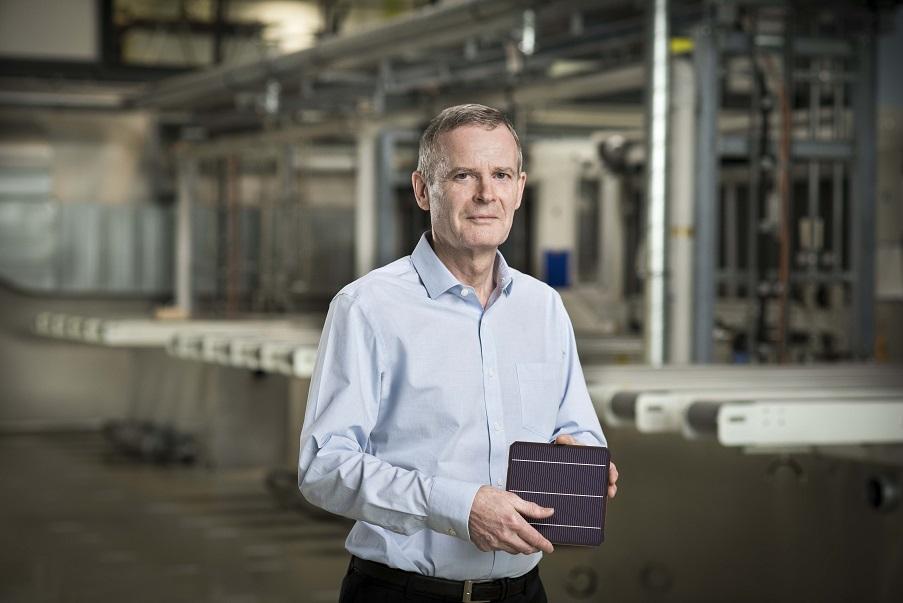 Oxford PV_Frank P Averdung, CEO Oxford PV, holding perovskite tandem solar cell